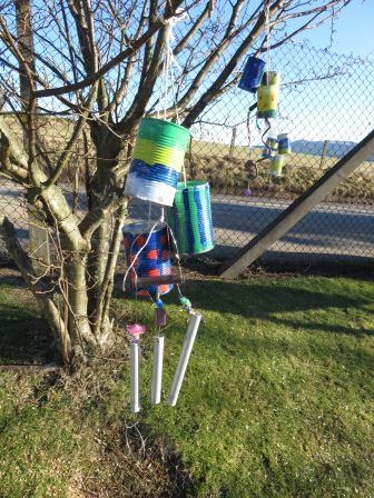 Children from the Eco Club made beautiful wind chimes from old tin cans to decorate the school grounds